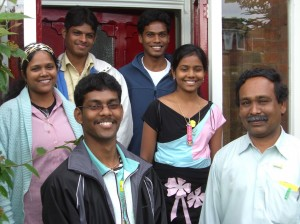 Photo: Suresh and family outside St Peter's Vicarage